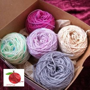 A sample box of Fingering weight 20 gram mini yarn cakes all set up and ready to use.