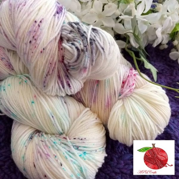 a delicate colorway of speckles in purples, pinks, aqua and grey